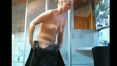 Sexy blonde mom taking a shower in the bathroom